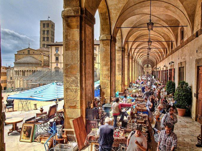 Antiques fair in the Loggia of the Piazza Grande in Arezzo, Italy